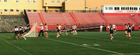 Girls varsity lacrosse shoots past Manchester