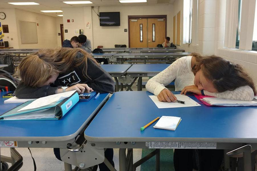 Johanna Golden (left) and Katie Souza (right) are tired after a long night of homework.