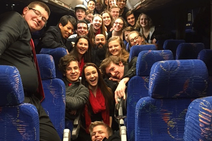 The group gets together for one last picture on the tour bus.