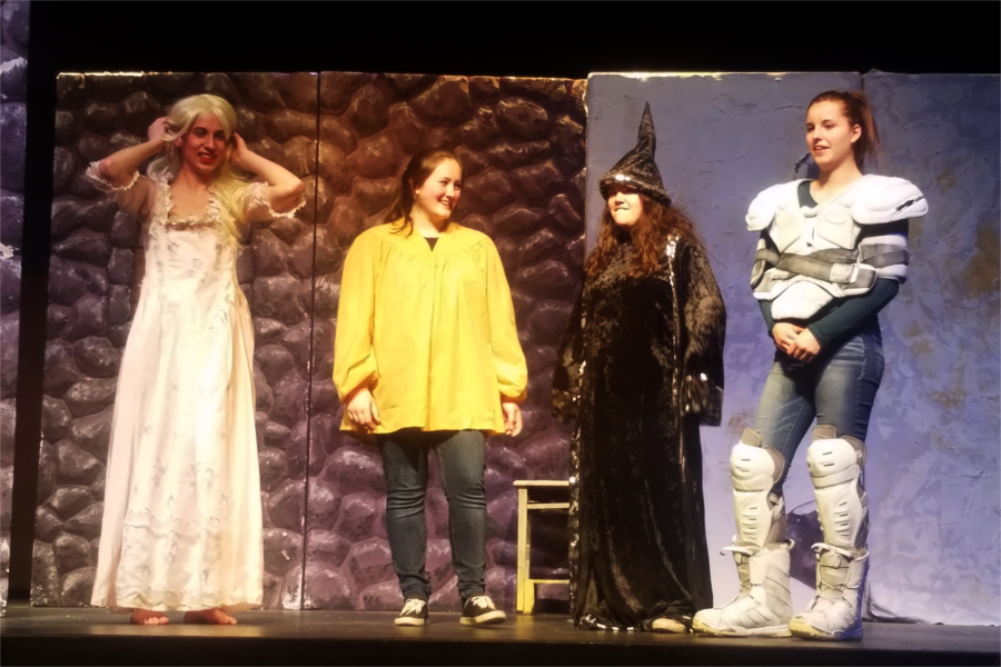 Seniors Aaron Velez, Paige Gionet, Lauren Moura, and Abby Rogers appear on stage together during the final scene.