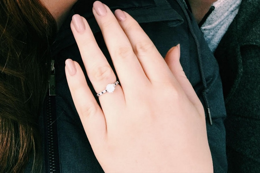 Millette shows off her new ring.