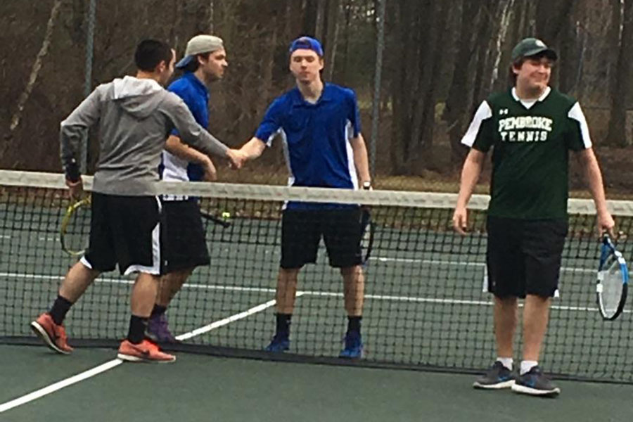 Sam Hall '17 and Patrick MacDonald '18 shaking hands after a doubles match