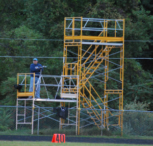 The scaffolding used for filiming and the teams' coaches at Coach Korcoulis Field