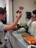Andrew Butler, '15, buying from the cullinary club's food stand after school.