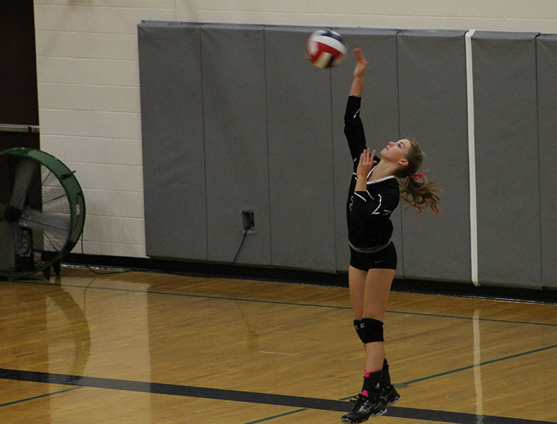 Sophomore Bella Zampieri serves the ball to the opposing team.