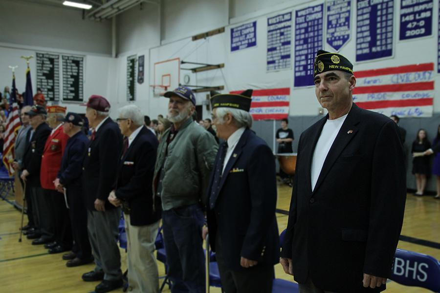 Veterans standing at attention for the National Anthem.