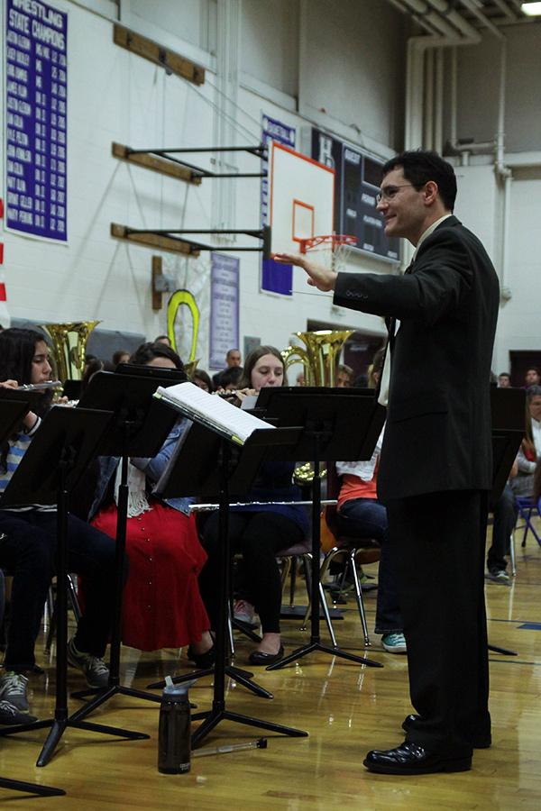 Mr. Umstead leads the Concert Band at the assembly.