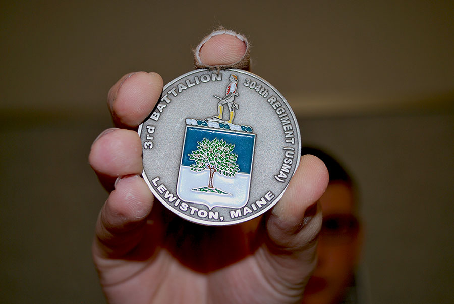 Ethan Sanborn's military coin that he received for the Veteran's Day Assembly