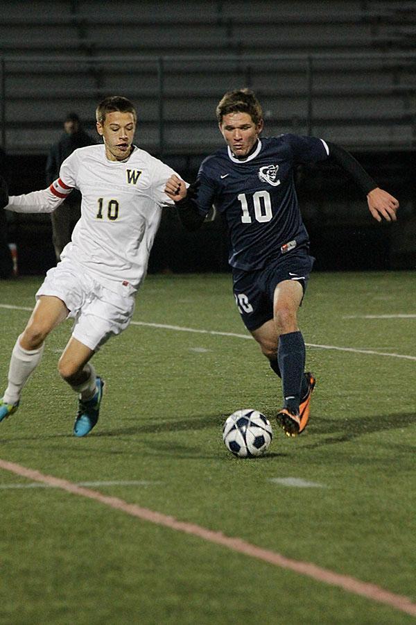Harrison Fetter goes shoulder to shoulder with Windham player