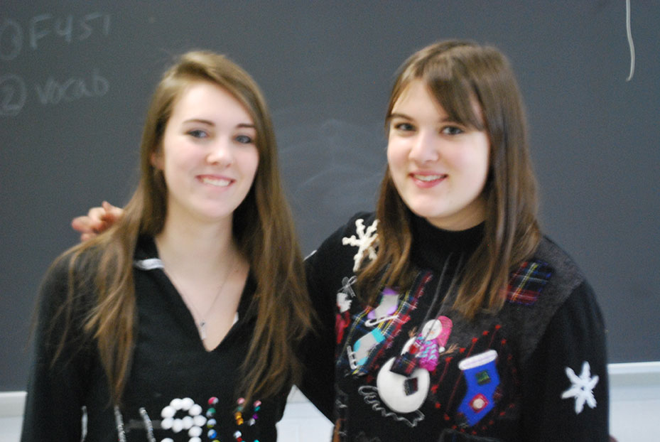 Kelley Barrett and Olivia Black, '14, show their school spirit on Ugly Sweater Day