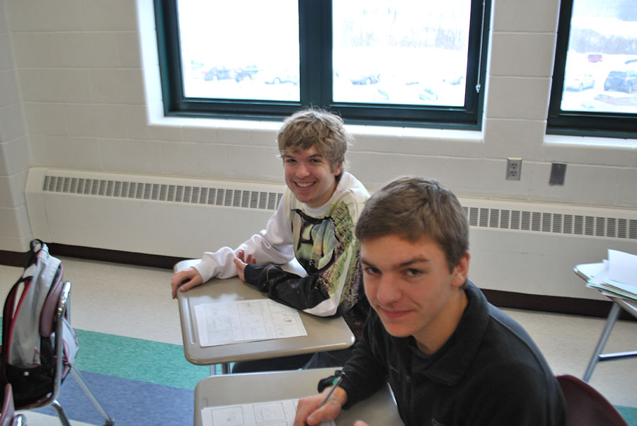 Caleb McGrath and Kevin Delaney, '14, working in class on Ugly Sweater Day