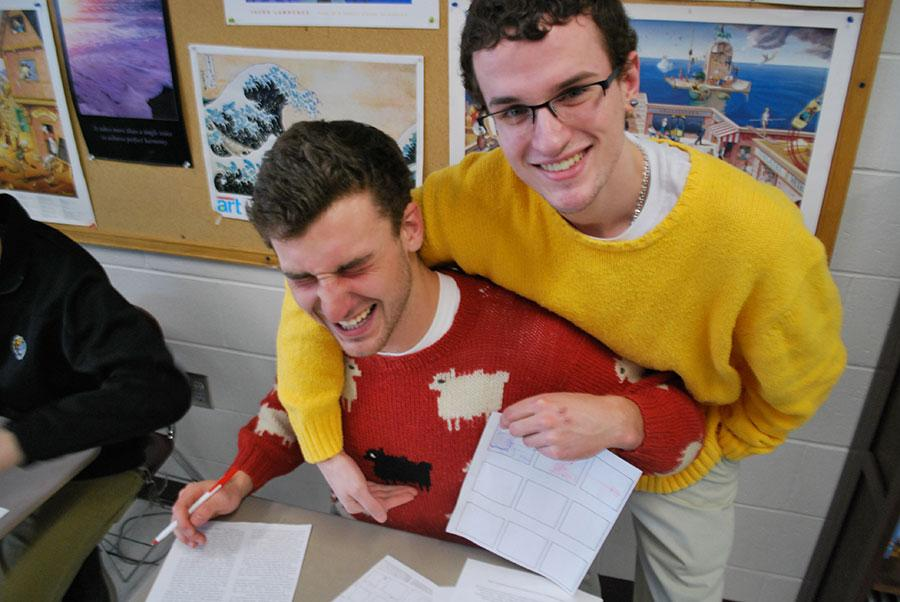 Jared Noftle and Ryan Lecours, '14, sharing a laugh on Ugly Sweater Day
