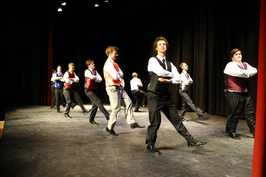 The men end the show with a repetition of their opening dance.