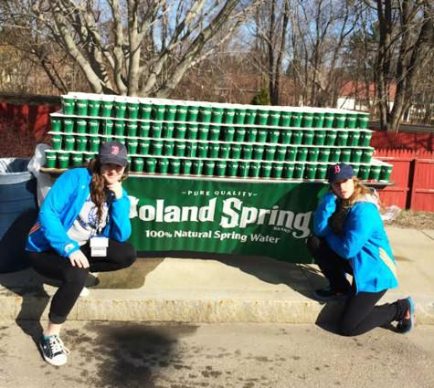 Seniors Maddy Snow and Jess Ciarcia handed out water at the 5th mile mark of this year's Boston Marathon.