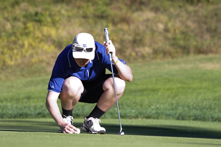 Golf team captain Ryan Buckley '14 sets up a shot.