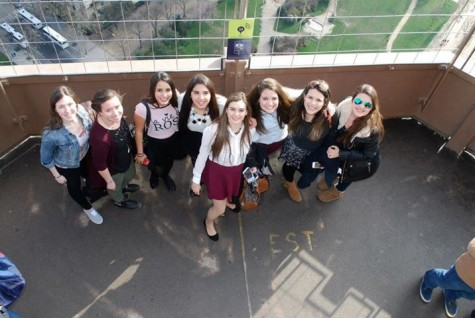 Emma Close and friends standing in the Eiffel Tower.