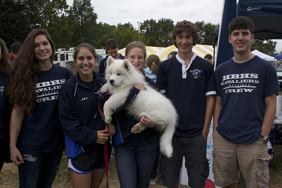 Pictured above is the crew team holding a fluffy friend at their Old Home Days booth. From left, Samantha Couture, '15, Shannon Fitzpatrick, '16, Kendall Pestana '16, Patrick Clark '15, and Jeff St. Hillaire, '15.