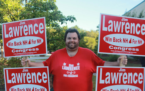 Richard Lowrance, assistant campaign manager holds signs for Jim Lawrence (r), who ran for congress but lost in the primary. Photo Credit: Julie Christie