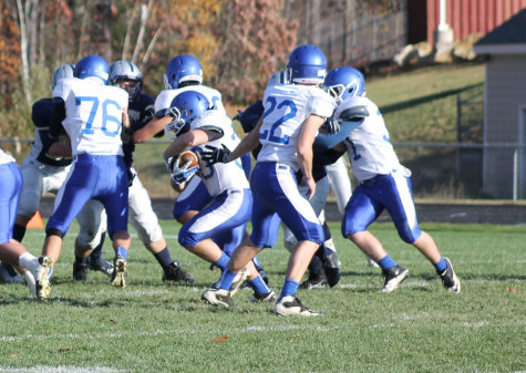 Wyatt Farwell runs the ball down field with help from offensive line