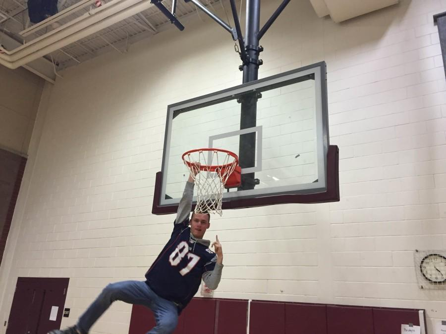 Matt Fothergill, '15 hanging from the hoop.