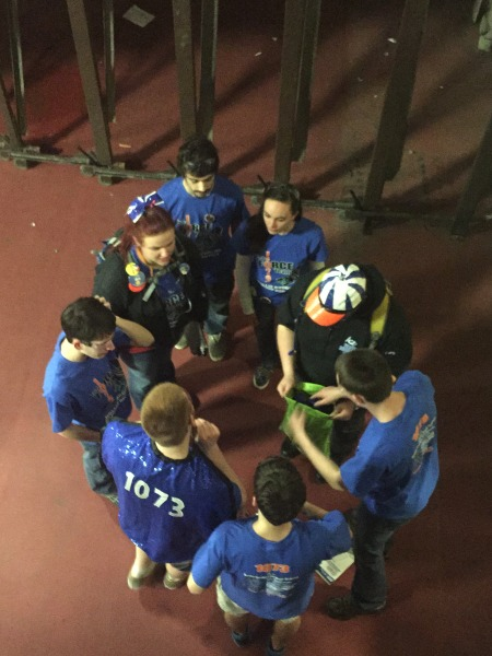 Members of 1073 huddle together during the competition.