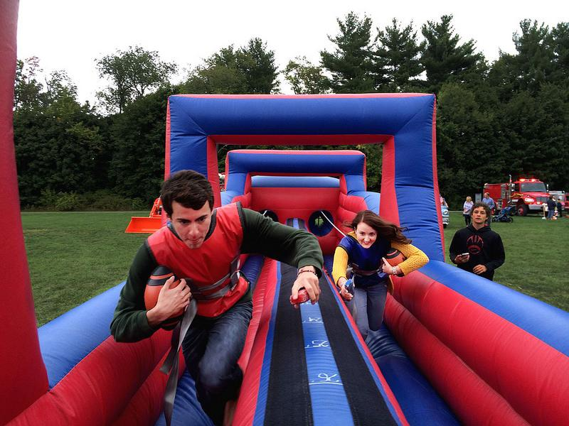 Elliot Rowe '15 beats another senior in a race through an inflatable obstacle course.