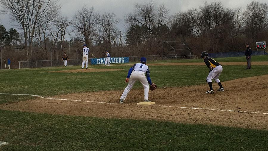 Jack Macleod '17 holds on a runner at first while James McCann '15 get set to deliver his 5th inning pitch.