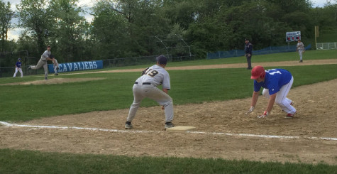 Ian Mauch '18 slides back into first  base on  a pick off attempt.