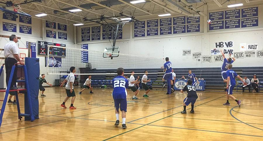 Nick Wood '17 prepares to launch a ball over the net as Aaron Campbell '15, Bobby Ripley '15, Bret Belden '16, Nate Thomas '16 and Zac Crooks '16 look on.