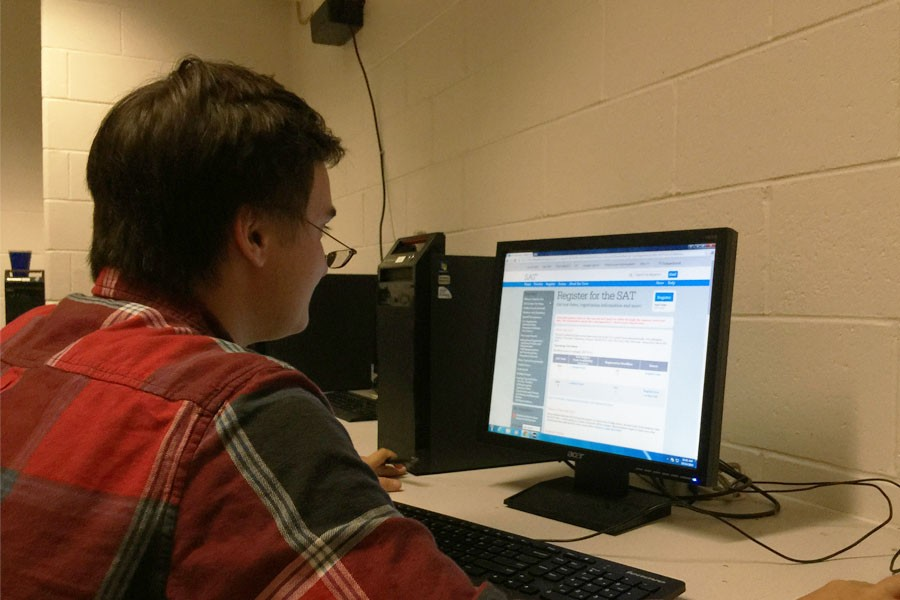 Keenan Troddyn '16 looks into the new, forthcoming SAT revisions online at home.
