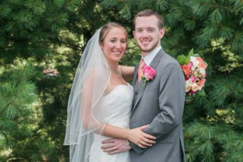 Mrs. Henderson with husband Reid at their wedding