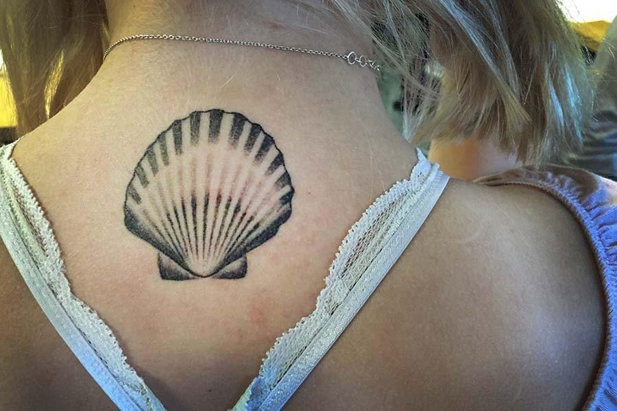 One of many of Gail Johnson's '16 tattoos, located on the back of her neck.