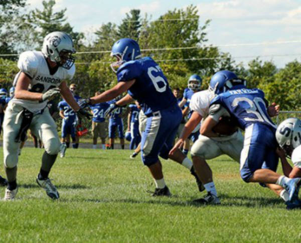 Wyatt Farwell '16 challanges a Sanborn defender in this year's September matchup at HBHS.