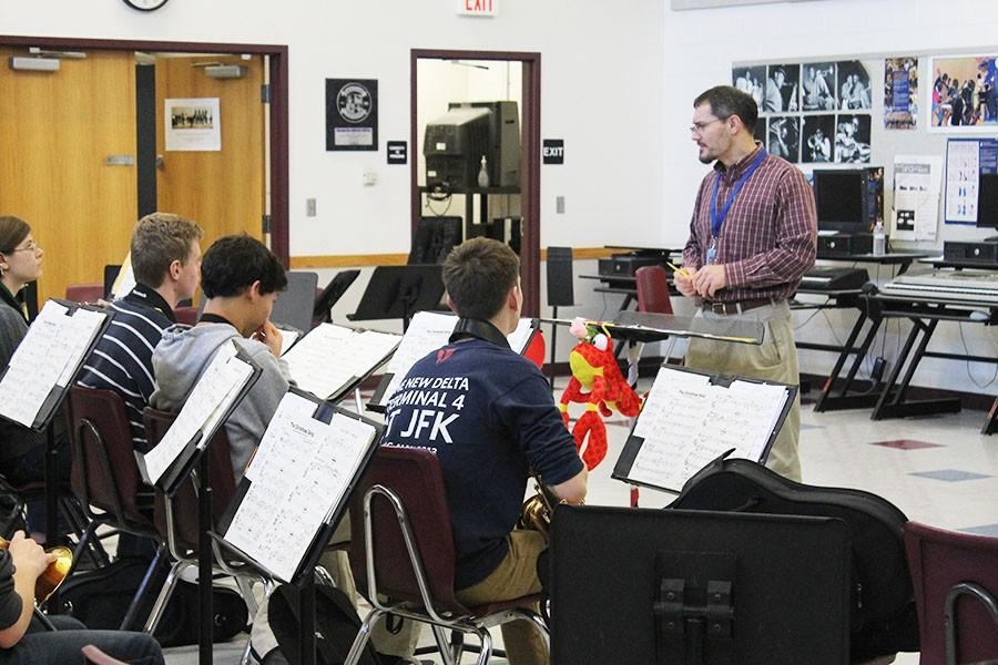 David Umstead helps his students improve their performances