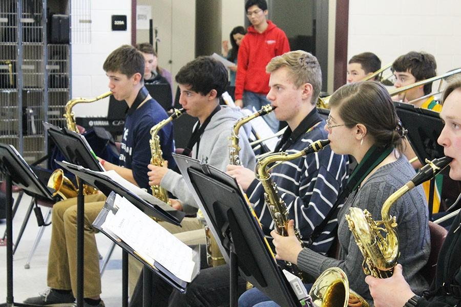 Students have to practice regularly to prepare for the music festival