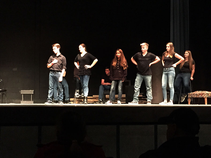 A group of the improv students perform a game onstage.
