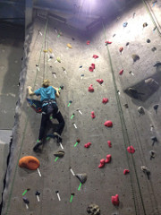 A climber of the climbing club scaling one of the many walls at Vertical Dreams.