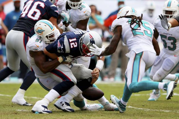 Brady takes a sack in Sunday's 20-10 loss in Miami.