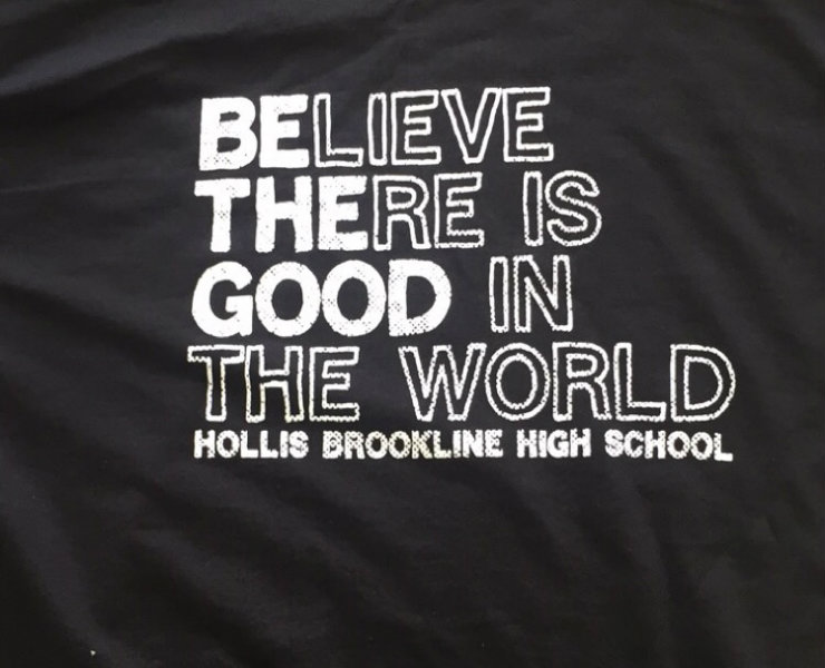 The StuCo T-shirt with motto of their council.