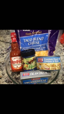 The ingredients for buffalo chicken dip, a popular snack on game day.