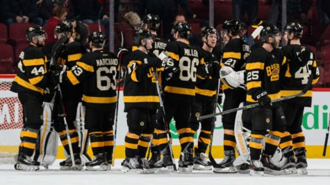 The Bruins congratulate one another following a 4-1 win in Montreal against the Habs.