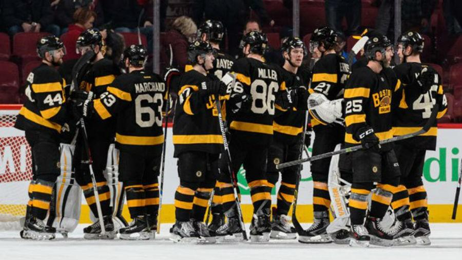 The+Bruins+congratulate+one+another+following+a+4-1+win+in+Montreal+against+the+Habs.+