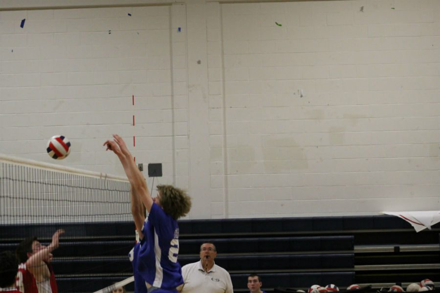 Tucker McIlwrath '16 goes up to make a block in a recent game this year.