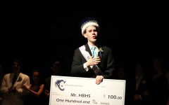 Bradley Simpson '16 accepting his winning check as Mr. HBHS 2016.