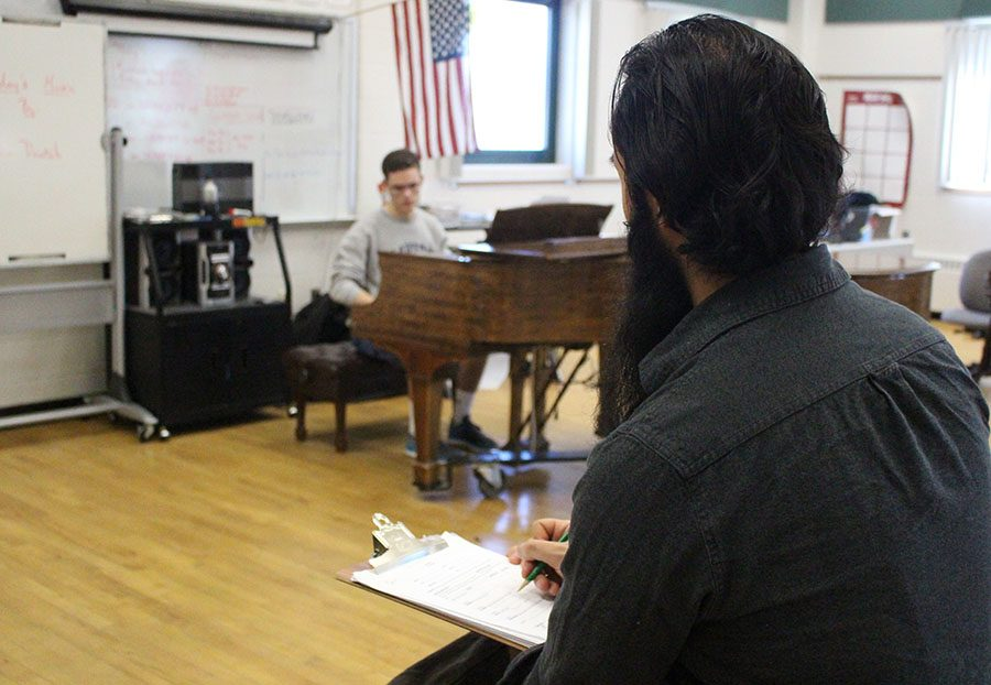 A student auditions for choir director Matthew Barbosa