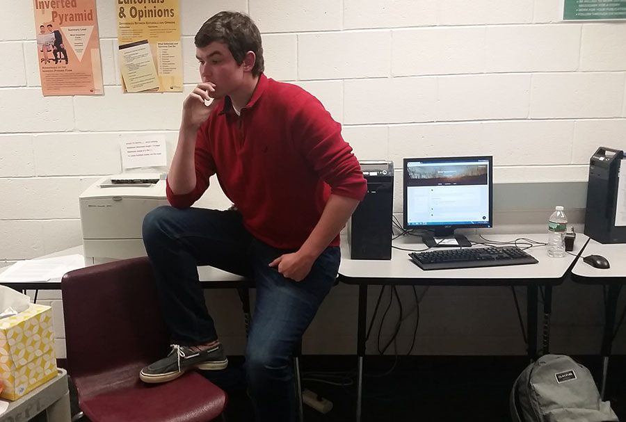 Gillis'17 ponders how to go about researching college football.