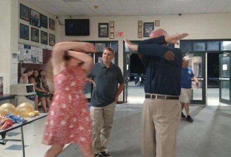 "Maggie O'Hara and English teacher Michael Fox attempt Fox's original dance move, the ""double dab"""