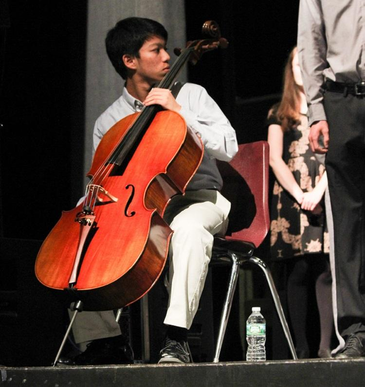Vivek Nithipalan '17 plays the cello as entertainment for the ceremony.
