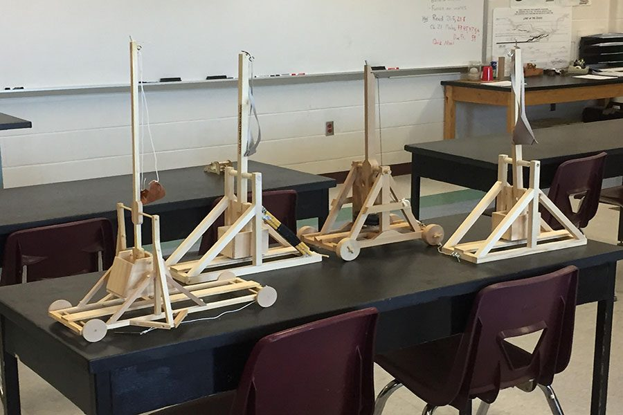 The physics club helped to entertain third grade visitors with these mini trebuchets on Trebuchet Day.