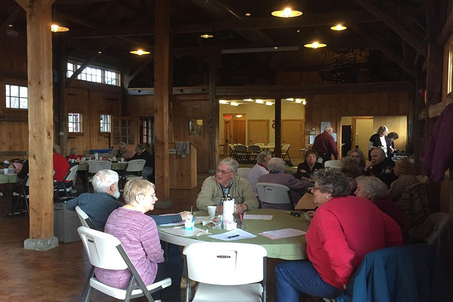Local seniors gather to discuss important issues with the Hollis Police Department at the annual Coffee with a Cop event.
